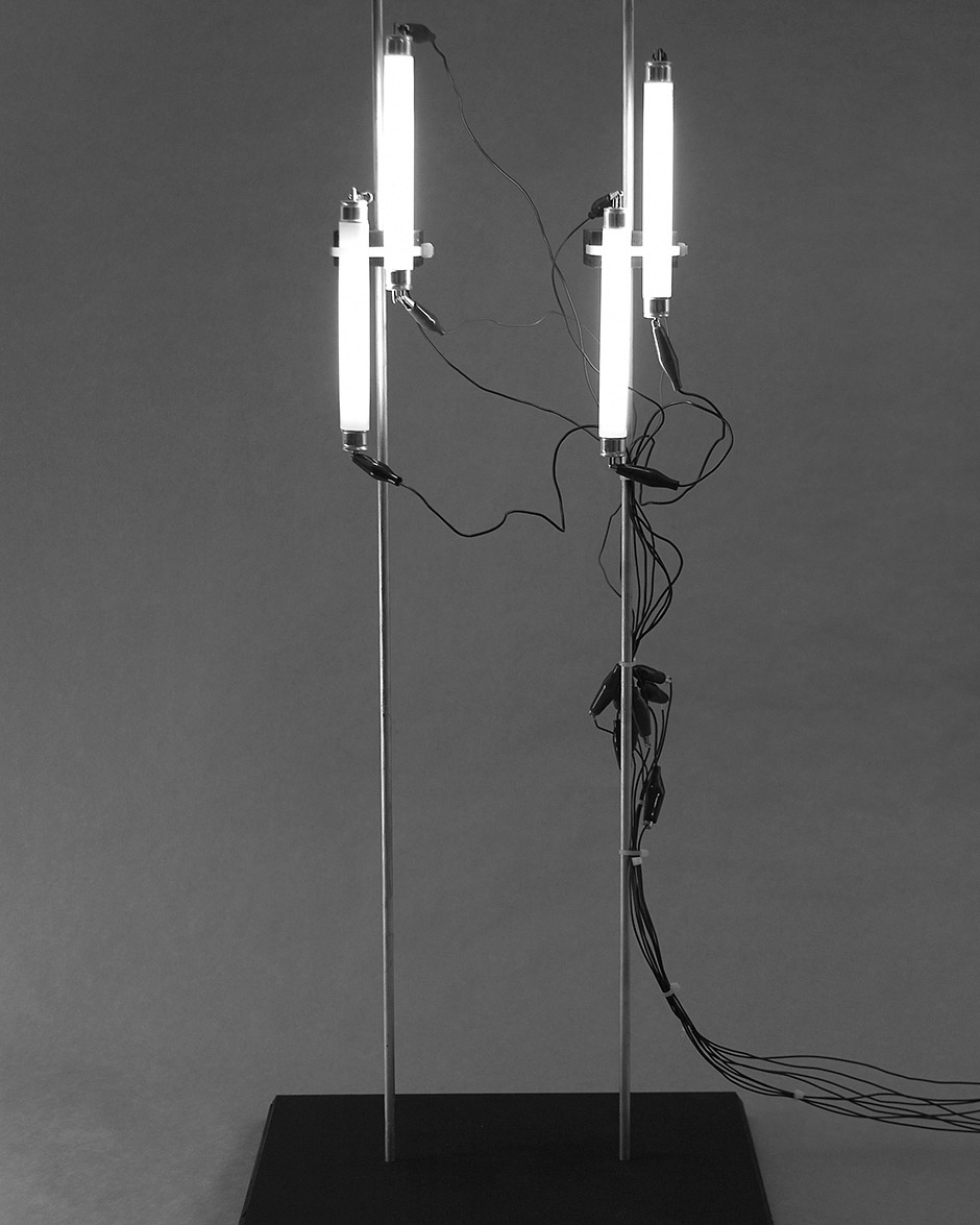 Two-Stack Stations, Coster Scott, 2004. wood, steel, krylon paint, florescent lights, electronics. Approx. 16″ x 13″